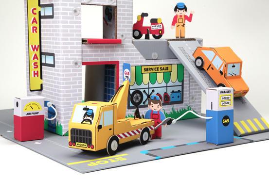 EXKLUSIVES FUR KIDS - Maison de poupée-EXKLUSIVES FUR KIDS-Garage frères willson en carton recyclé 73x56x43cm