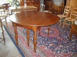 Au Mobilier Vendéen - table ronde noyer - Tavolo Allungabile